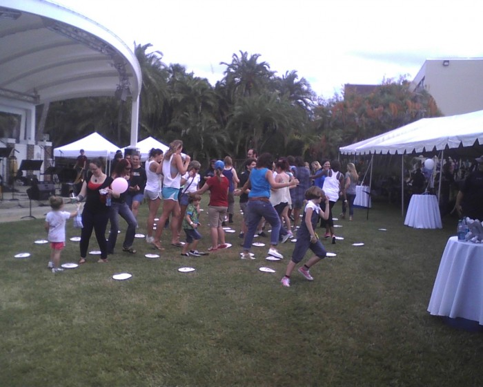 Audience members participate in the Cake Walk for a chance to win a gift certificate.