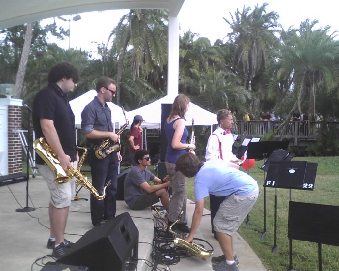 Members of Florida Tech's concert band prepare to play at the President's Picnic.