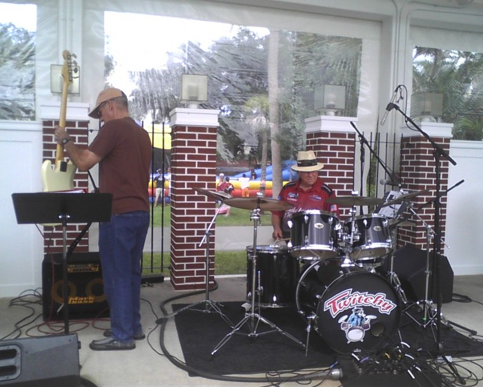 """President Catanese prepares to play the drums for """"Zoot Suit Riot."""""""