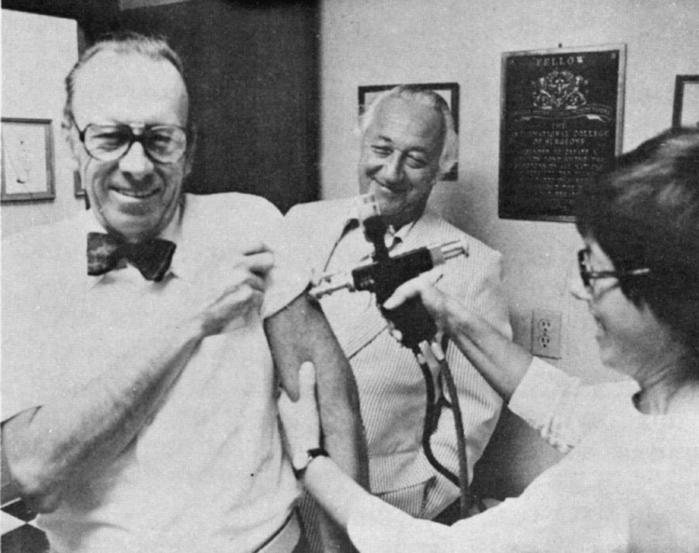 Photo of Jerry Keuper receiving a flu shot with Oswald Holzer.