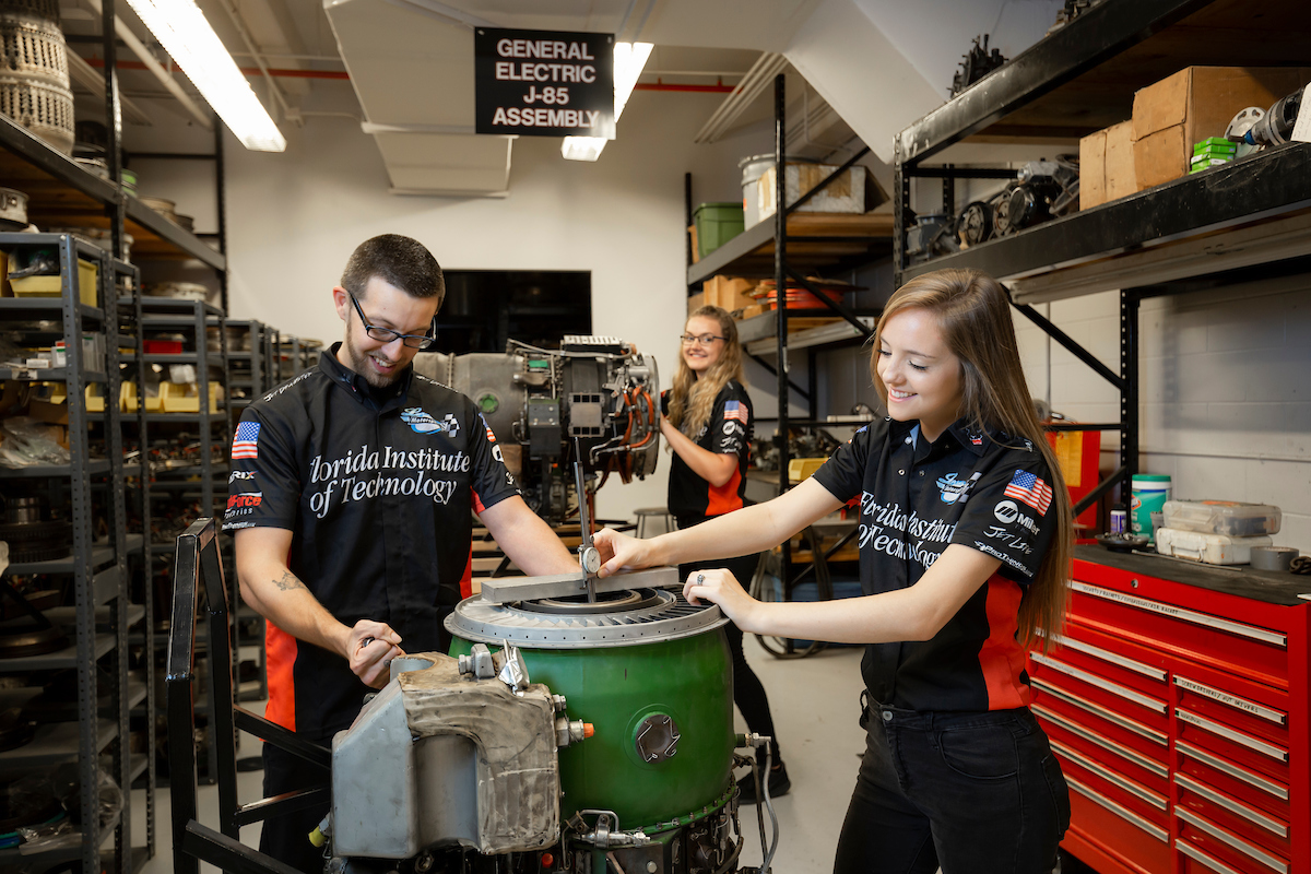 Florida Tech students working at the Larsen Motorsports Engine Lab