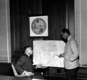 Tom Adams, Florida Secretary of State, and Randolph Hodges study map