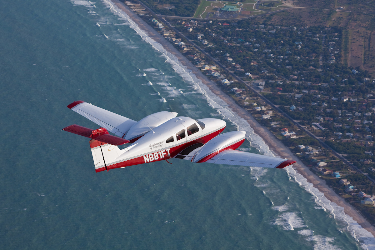 FIT Aviation Piper Seminole Plane in flight over space coast