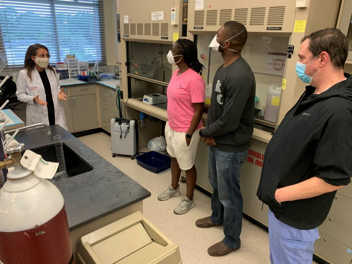 Students from Burrell College of Osteopathic Medicine speak to Florida Tech assistant professor Kenia Nunes, a vascular biologist, during a recent tour of campus. Nine Burrell students are on the Space Coast to participate in clinical rotations at Steward Health Care facilities.