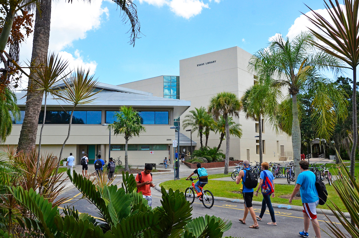 Students walk near Evans Library on the Florida Tech campus in Melbourne.