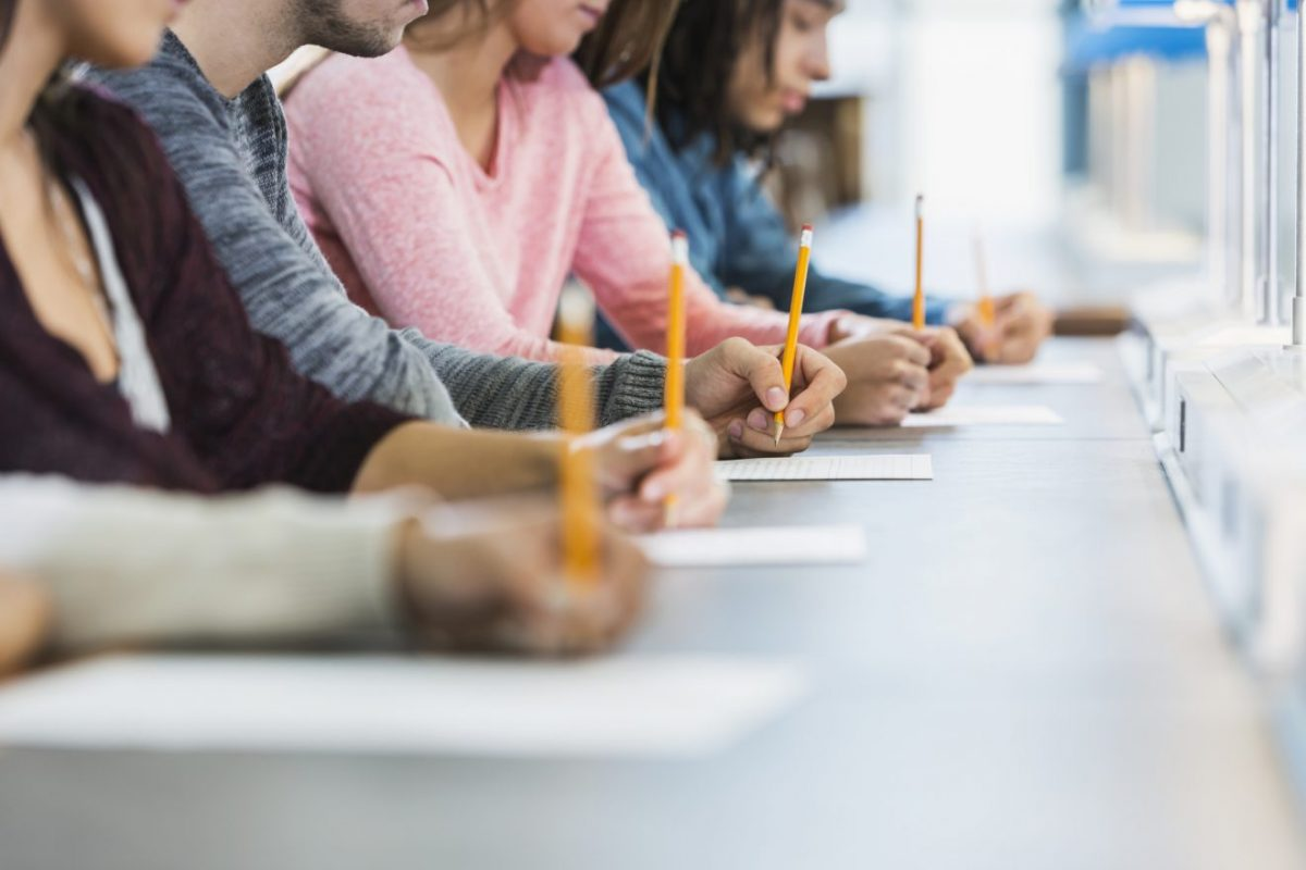 A group of students taking a test.