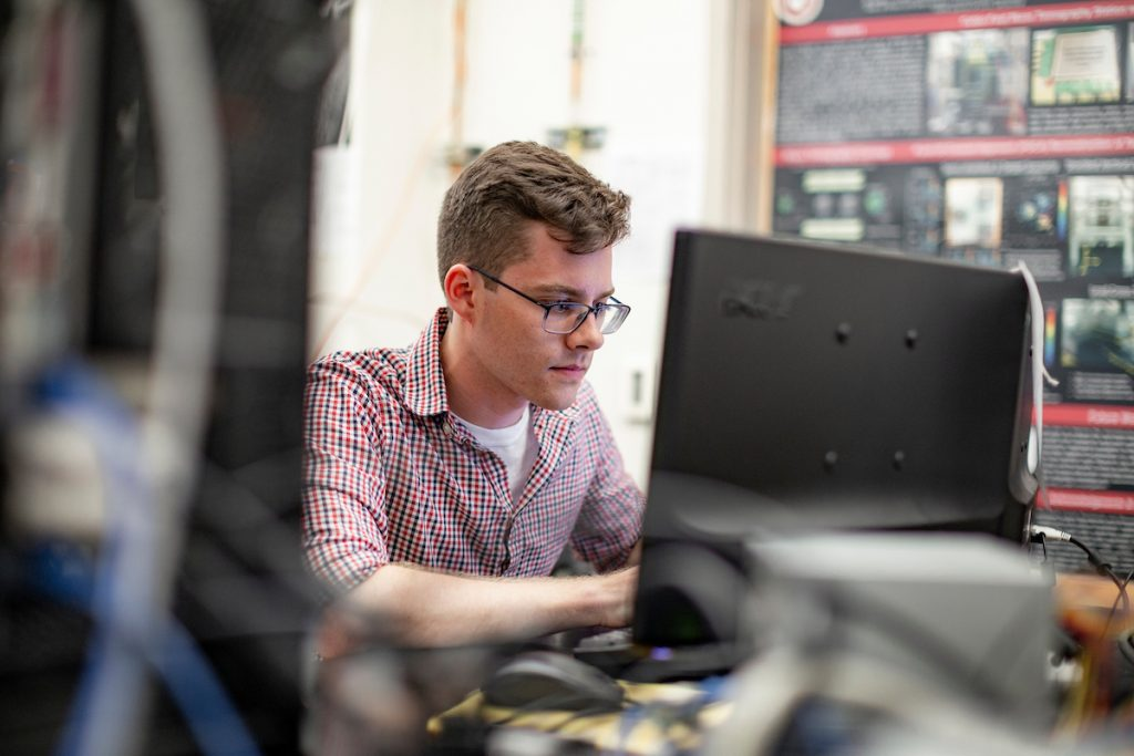 A computer science student at florida tech works in the lab