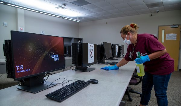 Florida Tech staff cleaning computer lab