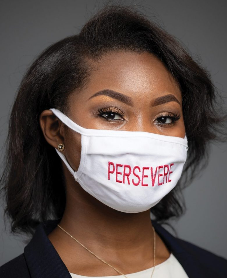 """Furaha Merritt, a senior information systems major and president of the Black Student Union, wearing a face mask reading """"Persevere"""""""