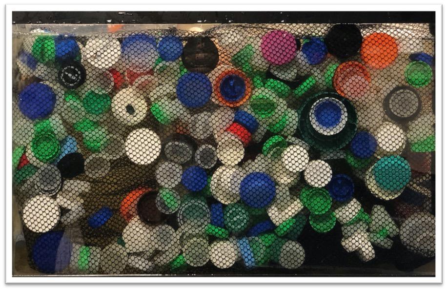 Mesh bag containing plastic bottle caps