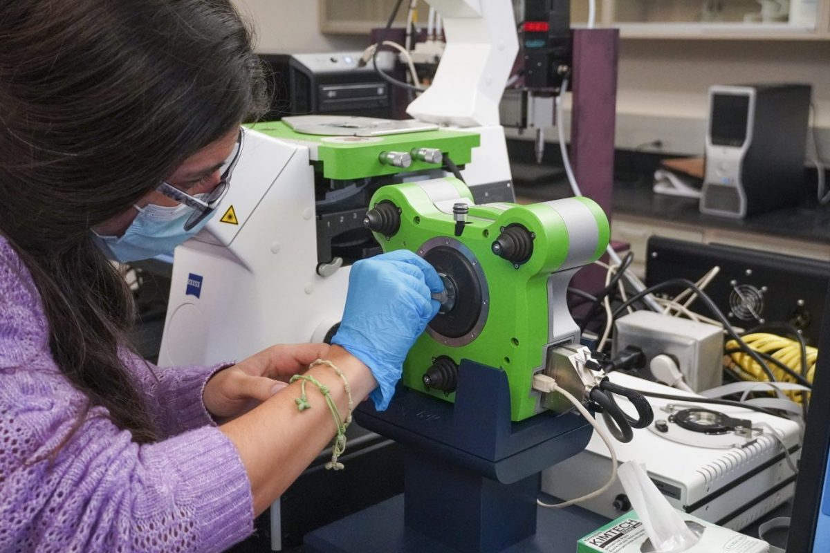 Ana Isabel Delgado, a graduate student, working on the university's new atomic force microscope housed in Professor Linxia Gu's Bio-Mechanics Laboratory