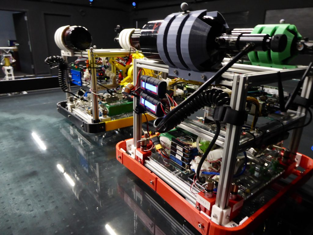 Air-bearing vehicles (ABVs), seen here and used for experiments in the ORION Lab, have capabilities and limitations similar to actual small spacecraft.
