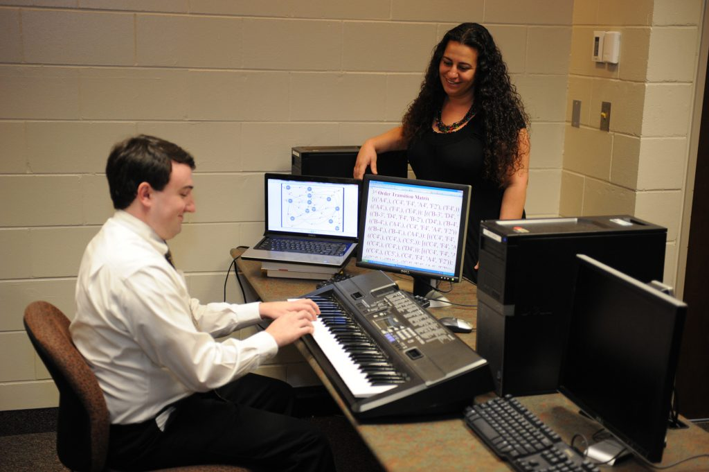 """Dr. Munevver """"Mine"""" Subasi works with a student on his senior design project."""