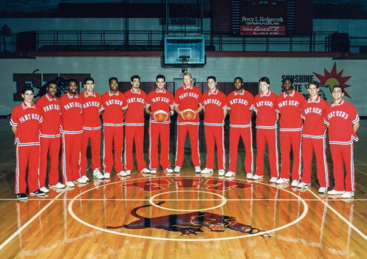 Basketball team in uniform standing around center court