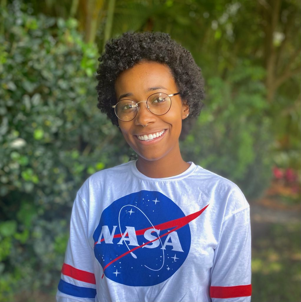 Jordan Forman who interned at NASA shown smiling in a NASA Tshirt