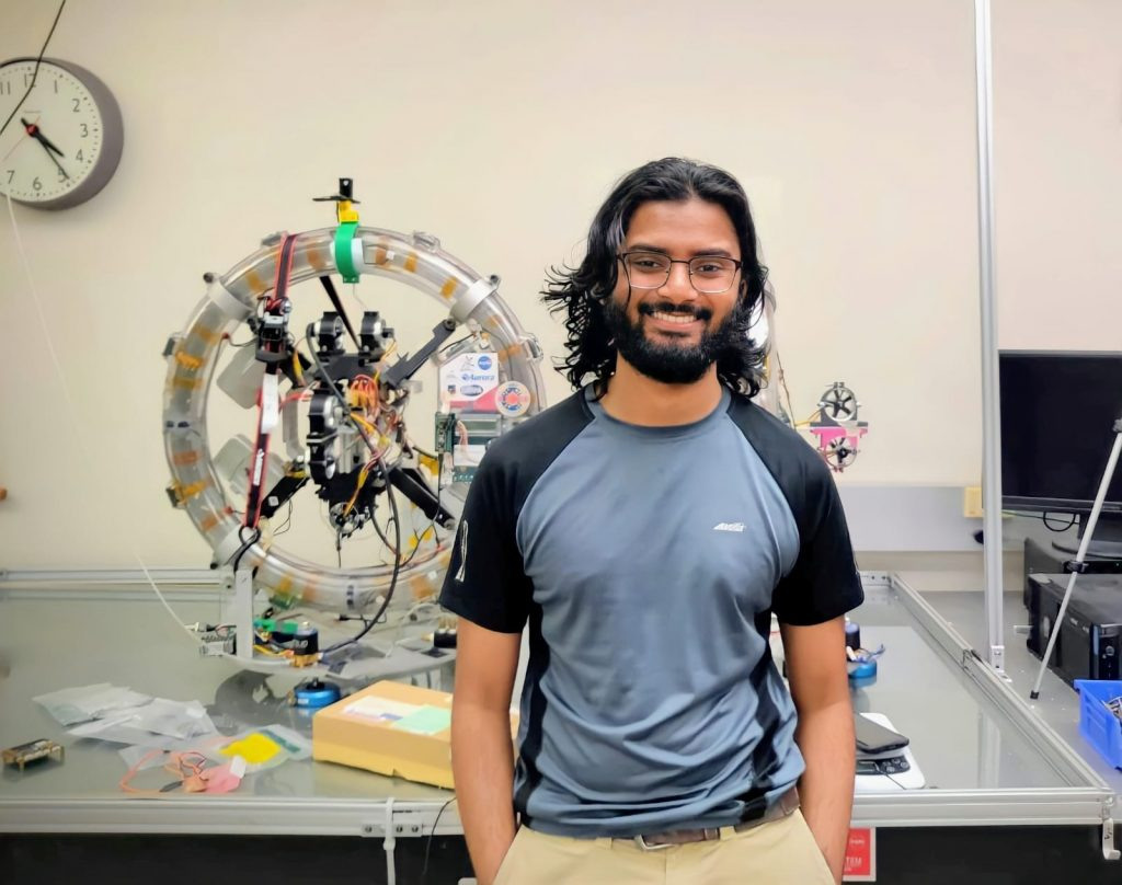 Mamoon Syed standing in lab used by aerospace engineering students